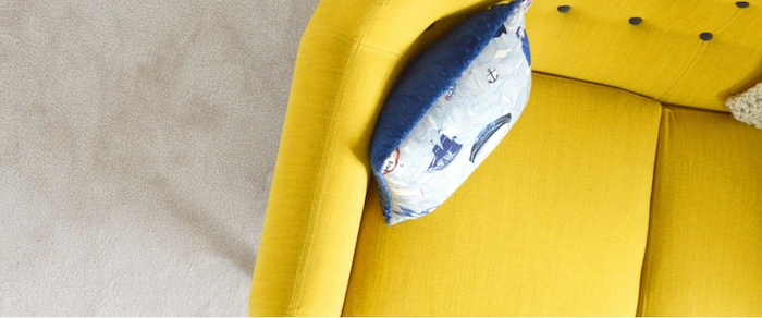 Yellow-retro-buttoned-upholstered-couch